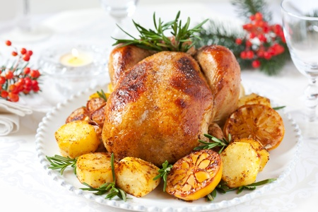 baked chicken: Roast chicken with potatoes,lemons and rosemary for Christmas