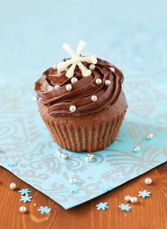 Christmas chocolate cupcake decorated with snowflakes photo