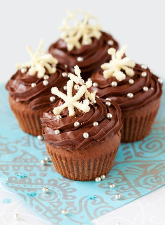 Christmas chocolate cupcake decorated with snowflakes photo