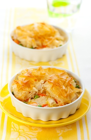 casserole dish: Creamy mustard chicken pot pie with vegetables  and filo Stock Photo