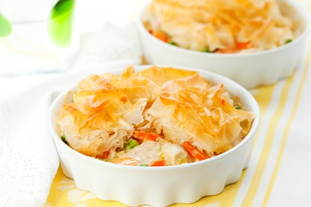 Creamy mustard chicken pot pie with vegetables  and filo photo