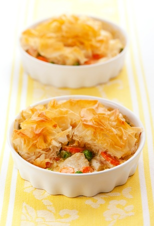 filo: Creamy mustard chicken pot pie with vegetables  and filo Stock Photo