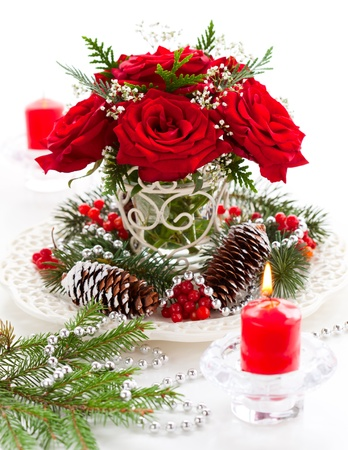 Christmas arrangement of red roses,fir, holly and pine cones Stock Photo