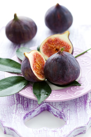 Several whole figs and one halved fig photo