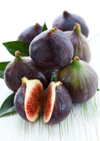purple fig: Several whole figs and one halved fig