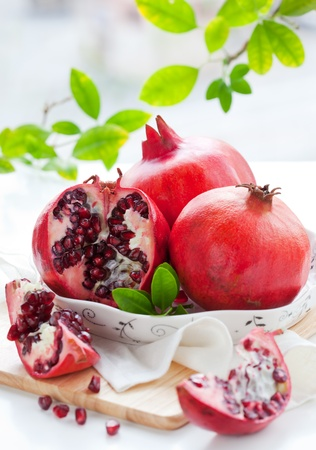 pomegranates: Pomegranates, whole and cut open