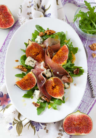 salad with fig,blue cheese,prosciutto and nut photo