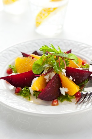 gourmet meal: salad of beetroot,goat cheese,orange and pomegranate