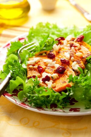 Roasted butternut squash salad with cheese,nut and cranberry Stock Photo