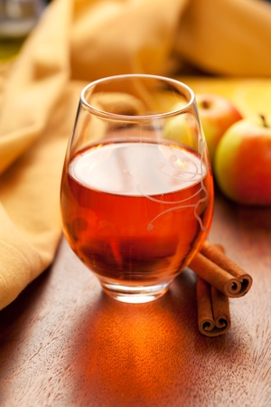apple christmas: Apple cider with cinnamon sticks Stock Photo