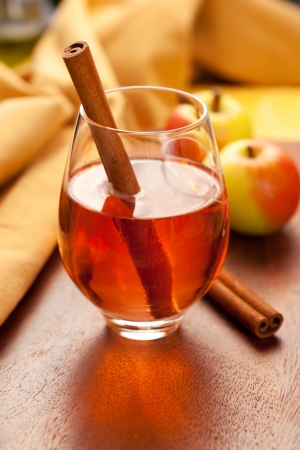 Apple cider with cinnamon sticks photo