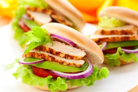 chicken burger: sandwich with chicken,avocado and tomato
