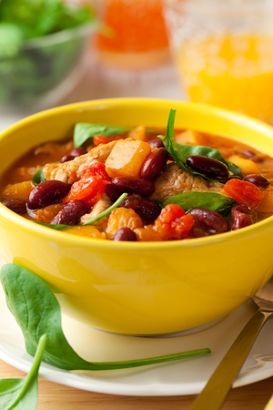 Turkey and red bean ragout with pumpkin,tomatoes and spinach photo
