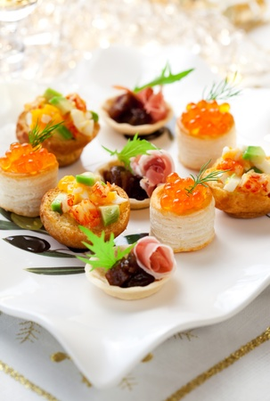 food buffet: Assorted savoury holiday snacks on plate Stock Photo