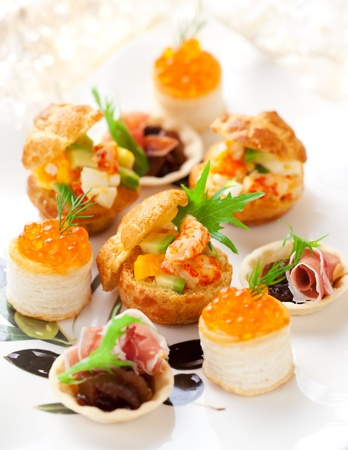 party food: Assorted savoury holiday snacks on plate Stock Photo