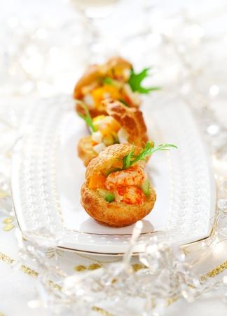 tartlet: Prawn salad with egg and avocado in mini-brioche for holiday Stock Photo