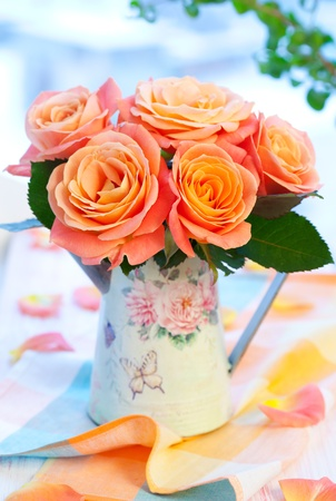Bouquet of salmon-pink roses  in a jug photo