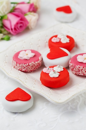 marzipan: Sweet Valentine Petit Fours on a plate Stock Photo