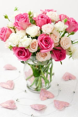 festive bouquet of pink and white roses in vase photo