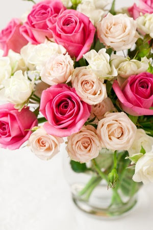 festive bouquet of pink and white roses in vase Stock Photo