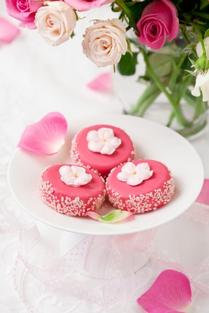 pink cake: petit fours for holiday and flowers
