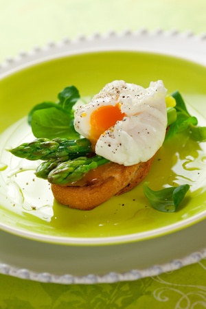 Poached egg and green asparagus on toast photo