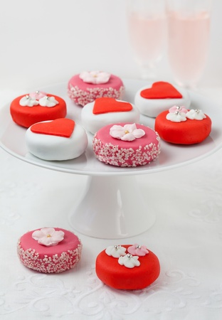 Sweet Valentine Petit Fours on a cake stand photo