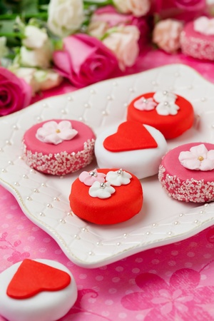 sweet heart: Sweet Valentine Petit Fours on a plate Stock Photo