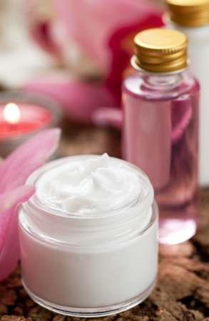 spa still life: skin cream,flower and cosmetic products