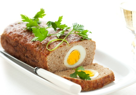 baked meatloaf with boiled eggs for Easter photo