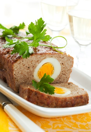 baked meatloaf with boiled eggs for Easter Stock Photo
