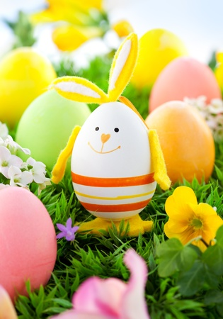 colorful Easter Eggs and rabbit on the grass photo