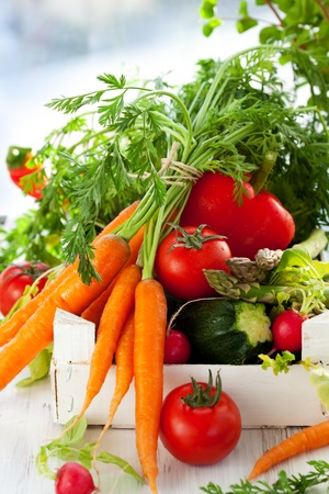 vegan food: Different fresh vegetables in a box Stock Photo