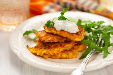 Carrot pancakes with rucola and  yoghurt photo