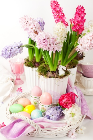 Easter table arrangement with hyacinths and eggs photo