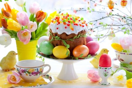 easter decorations: Easter cake and colourful eggs on festive Easter table