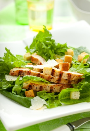 CHICKEN CAESAR SALAD: Chicken Caesar salad  on the white plate Stock Photo