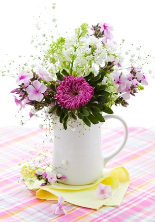 Spring arrangement of aster,phlox and lilac photo