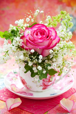 Pink rose and white lilac in a cup Stock Photo - 12659531