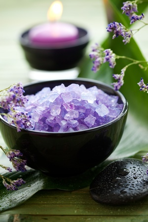 Spa essentials - bath salts, candle, stones, flower photo