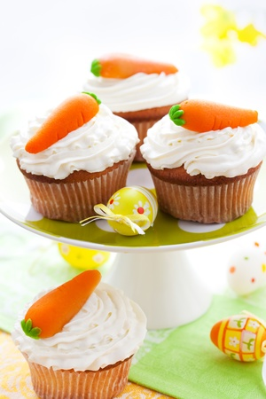 cakestand: Easter  cupcakes with marzipan carrots on a cakestand Stock Photo