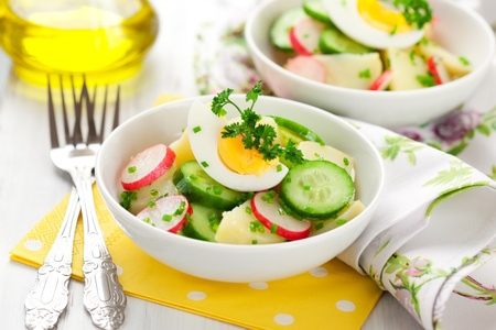 potato salad with egg,radishes and cucumbers photo