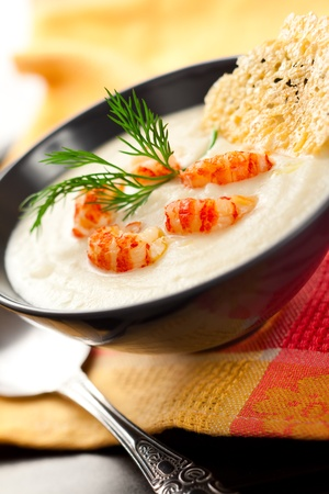 seafood soup: Cream of potato and celeriac soup with crab meat and parmesan crisps