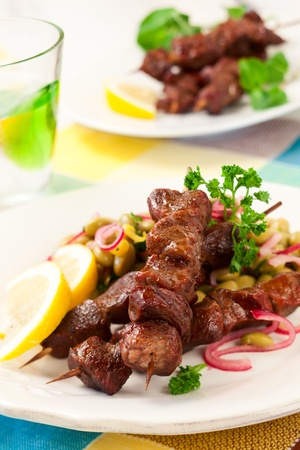 lamb meat: Grilled lamb kebabs with bean salad Stock Photo