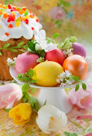 easter eggs  and cake on festive table photo