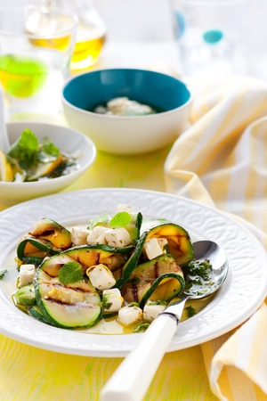 Grilled zucchini salad with feta,mint and lemon photo