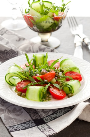 Smoked salmon salad with rocket,cucumber,tomato and capers photo
