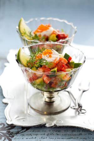 Shrimp, avocado, salmon and caviar cocktail  salad in a glass photo