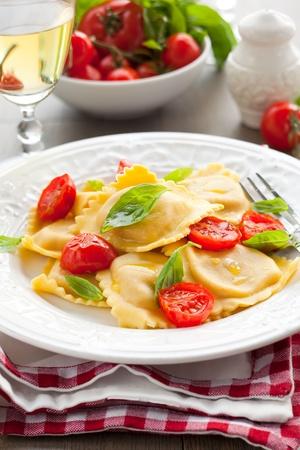 Ravioli with ricotta,tomatoes and basil photo