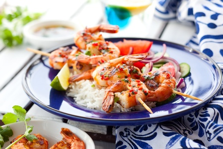 Prawn skewers with rice and vegetable salad photo